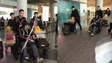 太拼了吧!吴京坐轮椅带拐杖现身机场